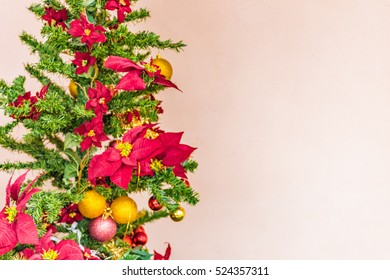 red, yellow and orange decorations on Christmas tree