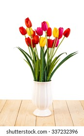 Red and Yellow and Pink tulips in pot on wood texture isolated on white background