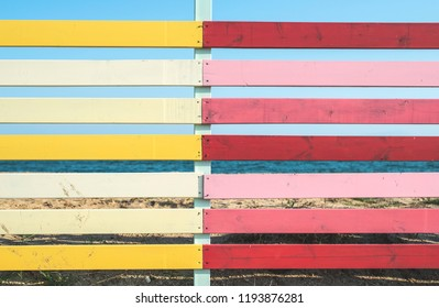 Red and yellow planks background. Sunny day