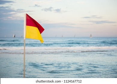 Red and Yellow Saftey Flag on Australian Beach on the Gold Coast