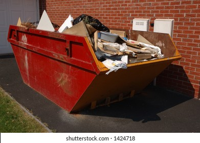 Red and yellow skip full of rubbish