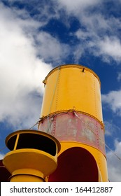 Red and yellow smokestack on an old steamer ship of the Year 1912
