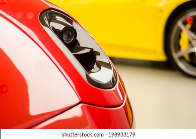 red and yellow sports cars