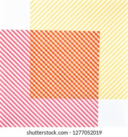 red and yellow striped paper on illuminated white background