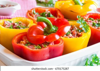 Red and yellow stuffed peppers