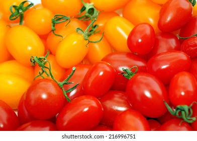 Red and yellow tomatoes cherry as background