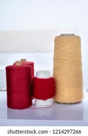 Red And Yellow Yarn Bobbins