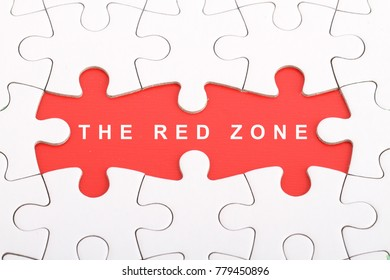 The Red Zone wording in the red are cover by a white puzzle