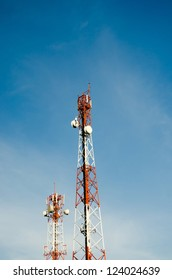 red-and-white-tower-of-communications-with-with-a-lot-of-different-antennas-under-clear-sky