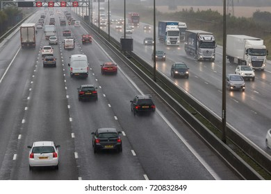 REDBOURN, UK - SEPTEMBER 21, 2017: Traffic on busy British motorway M1 in a bad rainy weather.