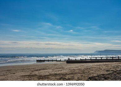 Redcar, Cleveland / England - May 12th 2019 : Redcar beach. Wooden sand fences along the beach. Huntcliff can be seen in the distance.