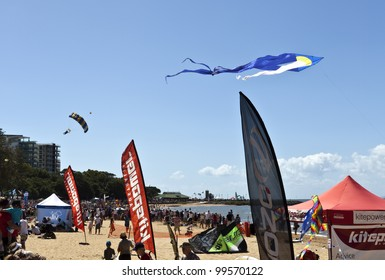REDCLIFFE - APRIL 6: Skydiver landing at the beach during the annual Festival of Sails on April 6, 2012 in Redcliffe, Queensland. The Festival of Sails is held annually on Easter Friday.
