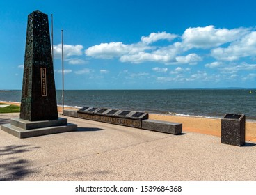 Redcliffe, Queensland, Australia, 10/21/2019: the main obelisk and plaques featured in the ANZAC memorial at the Redcliffe waterfront with a clear blue sky and Moreton Bay in the background