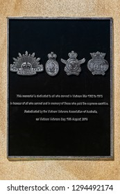 Redcliffe, Queensland, Australia - 1/13/2019: A closeup of the memorial plaque mounted on a sandstone obelisk featured at the seaside Redcliffe ANZAC memorial