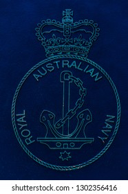 Redcliffe, Queensland, Australia, 12/2/2018: a closeup of the Royal Australian Navy cast in bronze badge set on a blue-black metal background featured in the ANZAC memorial at the Redcliffe waterfront