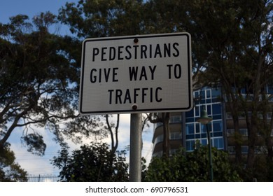 Redcliffe, Queensland, Australia. August 2017 - editorial use only: Moreton Bay Council's  'Pedestrians give way to traffic' sign at Suttons Beach Park.