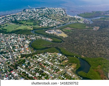 REDCLIFFE, QUEENSLAND, AUSTRALIA - : Cabbage Tree Creek (Tighgum) and associated mangrove wetlands, with wastewater treatment plant, with Shorncliffe suburb and golf course, on shores of Moreton Bay.