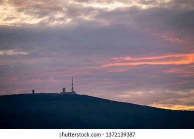 Red-colored clouds, sunset on the mountain Brocken in the National Park Harz