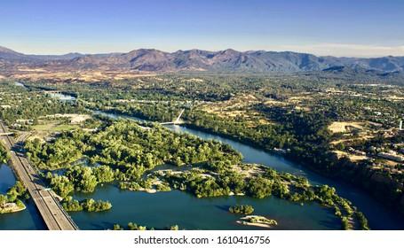 Redding California.  Sacramento River flows through Redding and past the Sundial Bridge.