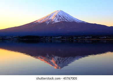 The reddish mountain Fuji and reflection