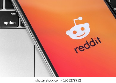 Reddit logo on the screen smartphone. Reddit - Social News Site. Moscow, Russia - November 15, 2019