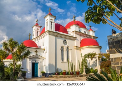The red-domed Greek Orthodox church of the Twelve Apostles near the shore of the Sea of Galilee at Capernaum, Israel. The church aka  the Church of the Seven Apostles, or Church of the Holy Apostles.