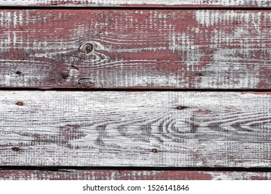 red-gray wooden background. horizontal boards. old paint peels off. old boards. Red gray wood texture of a worn painted board. Red gray wood texture of old worn painted board
