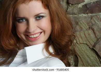 red-haired, blue-eyed girl with a beautiful smile