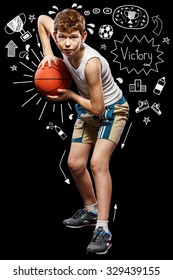 The red-haired boy with a basketball ball on a black background