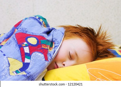 The red-haired boy sleeps