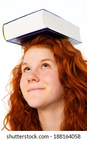 red-haired girl with book on the head
