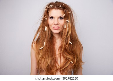 red-haired girl with clothespins in her hair