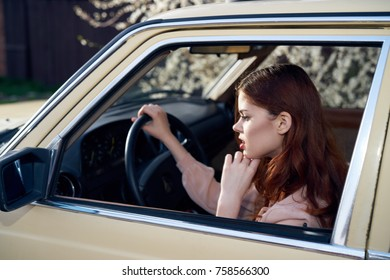 red-haired girl driving a car.