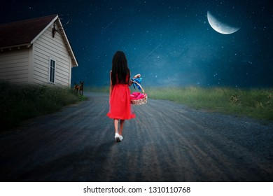 The red-haired girl holds a basket, walking along the path in a lonely half-moon night.