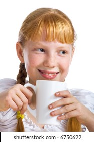Red-haired girl with a milk mug