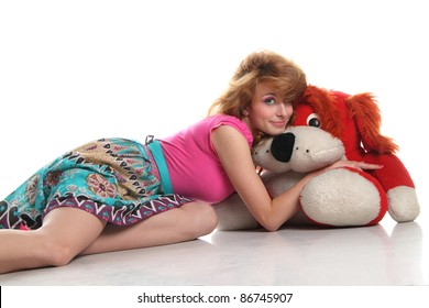 red-haired girl on white background with soft toys