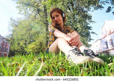 red-haired girl in park sunny day outdoor
