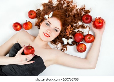 Red-haired girl with red apple