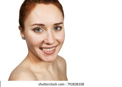 red-haired girl smiles and looking forward on wite back ground