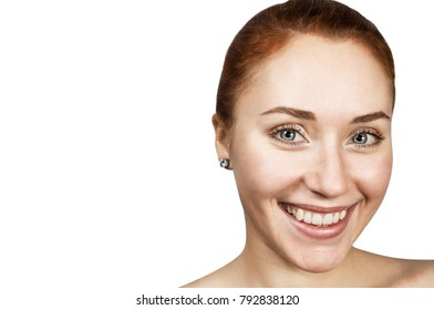 red-haired girl smiles on wite back ground