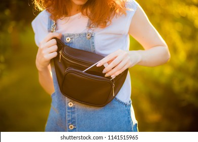 Red-haired girl with waist bag