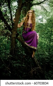 red-haired girl in wood on the tree