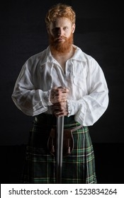 Red-haired historical Scotsman with a sword