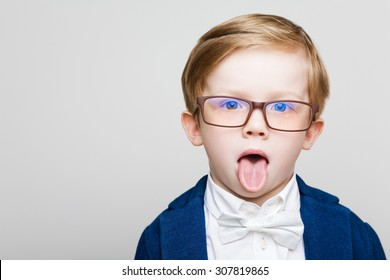 The red-haired kid with glasses showing tongue