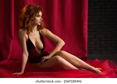 Red-haired sexy girl on red background