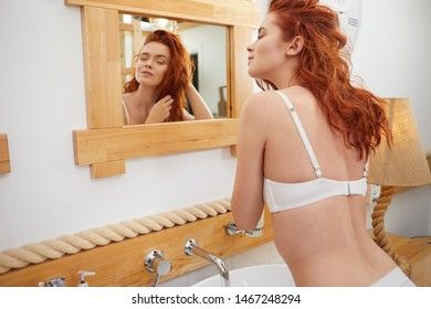 Red-haired woman in the bathroom