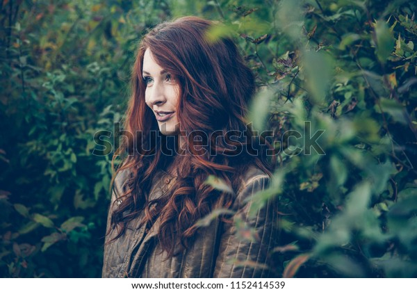 Red-Haired Woman Posing in Nature During Fall