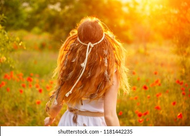 red-haired woman running in the sun.