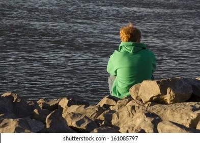 redhead boy by river