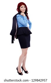 Redhead businesswoman, holding her coat over her shoulder in full length pose, isolated on white background